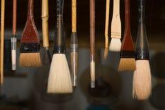 Escovas de vitrificação de suspensão Foto de Stock