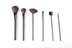Escovas do cosmético no fundo branco Foto de Stock Royalty Free