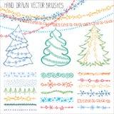 Escovas do feriado Doodles do Natal ajustados colorido ilustração royalty free