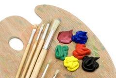 Escovas e paleta de pintura Imagens de Stock