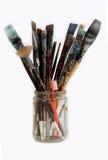 Escovas e toothbrush do artista imagens de stock