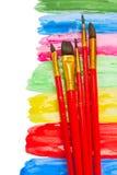 Escovas em pontos da pintura Fotografia de Stock