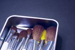 Escovas em um fundo escuro imagens de stock royalty free