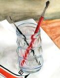 Escovas em um vidro Fotos de Stock