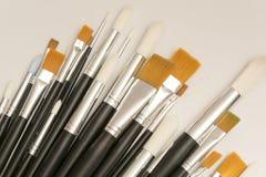 Escovas para tirar tamanhos diferentes fotografia de stock