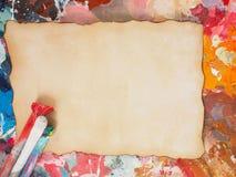 Escove e forre na paleta da óleo-pintura para o fundo Imagens de Stock Royalty Free
