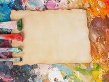 Escove e forre na paleta da óleo-pintura para o fundo Foto de Stock Royalty Free
