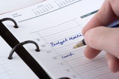 Escrevendo as nomeações do dia Imagem de Stock