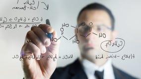 Escrevendo a fórmula química Fotografia de Stock