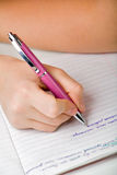 Escrevendo para baixo notas Imagem de Stock