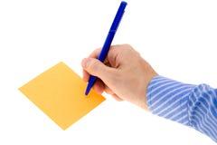 Escrevendo uma nota Fotos de Stock