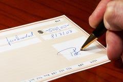Escrevendo uma verificação de banco Imagens de Stock Royalty Free