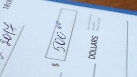 Escrevendo uma verificação para uma quantidade de dinheiro filme