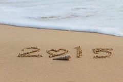 2015 escriben en la playa de la arena Imagenes de archivo