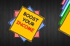 Escribiendo la demostración de la nota 'impulse su renta ' Foto del negocio que muestra para mejorar su trabajo a tiempo parcial  imagen de archivo libre de regalías
