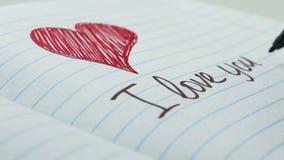 Escribiendo las palabras te amo almacen de metraje de vídeo