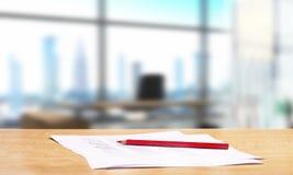 Escritório com mesa e o lápis vermelho imagem de stock