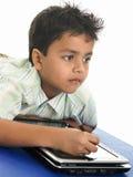 Escrita asiática do menino Fotos de Stock