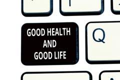 Escrita conceptual da mão que mostra a boa saúde e a boa vida A saúde do texto da foto do negócio é um recurso para viver um comp imagem de stock