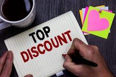 Escrita conceptual da mão que mostra o disconto superior Preço do texto da foto do negócio o melhor garantiu promoções de venda l imagem de stock