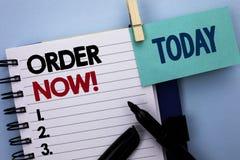 Escrita conceptual da mão que mostra a ordem agora Writte do registro do produto da loja da promoção de venda do negócio da ordem foto de stock royalty free