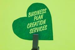 Escrita conceptual da mão que mostra serviços da criação do plano de negócios Pagar apresentando da foto do negócio pelo profissi foto de stock royalty free