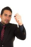 Escrita considerável nova do homem de negócios no whiteboard Imagem de Stock Royalty Free