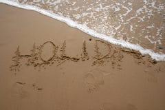 Escrita da areia - FERIADO 2 Fotografia de Stock