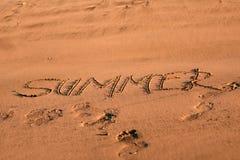 Escrita da areia - verão fotografia de stock royalty free