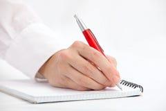 Escrita da mão com pena de ballpoint foto de stock royalty free