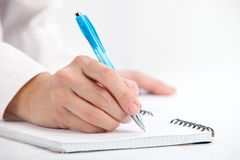 Escrita da mão com pena de ballpoint fotos de stock