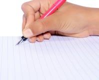 Escrita da mão com a pena isolada Imagens de Stock
