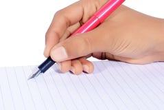 Escrita da mão com a pena isolada Imagem de Stock Royalty Free