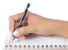 Escrita da mão no abook Imagem de Stock