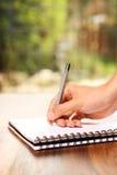 Escrita da mão no bloco de notas Imagens de Stock Royalty Free