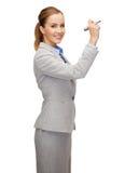 Escrita da mulher de negócios algo no ar com marcador Imagem de Stock