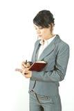 Escrita da mulher de negócio em um diário Fotografia de Stock Royalty Free