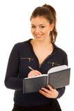 Escrita da mulher no caderno isolado sobre o fundo branco Fotografia de Stock Royalty Free