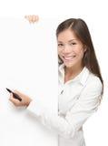 Escrita da mulher no sinal em branco Imagem de Stock Royalty Free