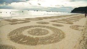 Escrita da praia na areia imagens de stock