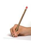 Escrita da rapariga no papel usando lápis foto de stock royalty free