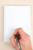 Escrita do caderno Foto de Stock