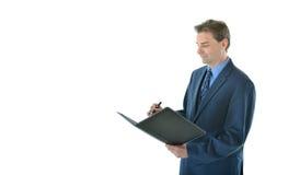 Escrita do homem de negócio no portfólio Imagem de Stock Royalty Free