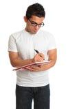 Escrita do homem em um bloco de notas do livro Foto de Stock Royalty Free
