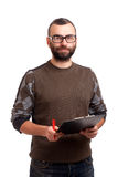 Escrita do homem novo em uma prancheta Imagem de Stock