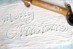 Escrita do Natal na farinha imagens de stock royalty free