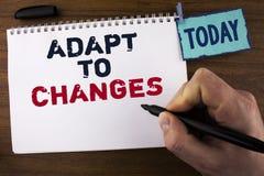 A escrita do texto da escrita adapta-se às mudanças Conceito que significa a adaptação inovativa das mudanças com a evolução tecn imagens de stock