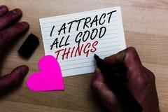Escrita do texto da escrita eu atraio todas as boas coisas Conceito que significa a afirmação positiva da motivação da lei da atr fotografia de stock