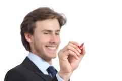 Escrita feliz do homem de negócios no ar com uma pena Foto de Stock