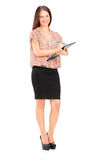 Escrita fêmea elegante em uma prancheta Fotografia de Stock Royalty Free